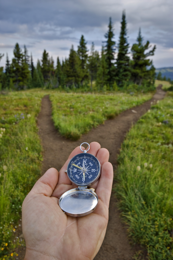 compass-in-hand-fork-in-trail